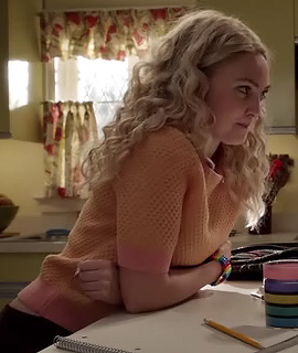 Carries peach orange and pink block waffle sweater on The Carrie Diaries