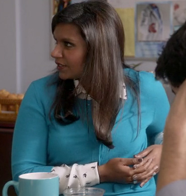 Mindy's turquoise blue cardigan and white longsleeve bird print shirt on The Mindy Project