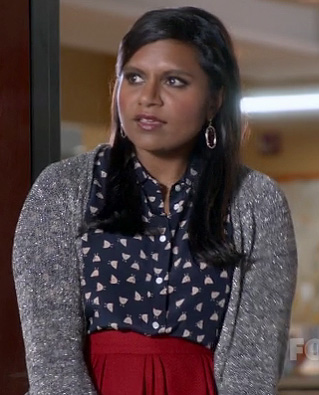 Mindy's navy blue printed shirt, red skirt and silver metallic cardigan on The Mindy Project