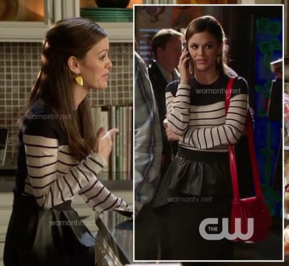 Zoe's black and white stripe top, asymmetrical leather peplum skirt and yellow earrings on Hart of Dixie