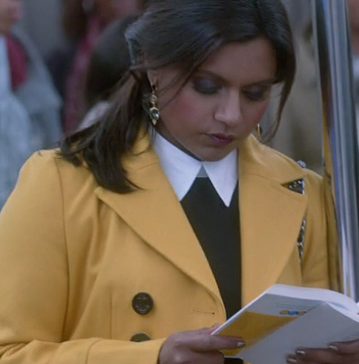 Mindy's yellow coat on the train on The Mindy Project
