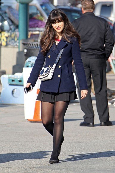 Jess's navy peacoat and black pleated skirt on New Girl
