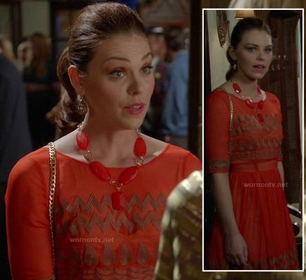 AnnaBeth's coral orange dress with gold zig zag pattern on Hart of Dixie