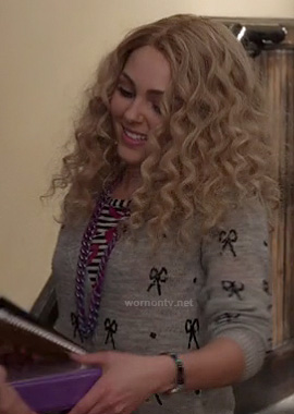 Carrie's grey sweater with sequin bows on The Carrie Diaries
