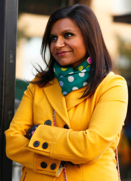 Mindy's yellow coat and green polka dot scarf on The Mindy Project