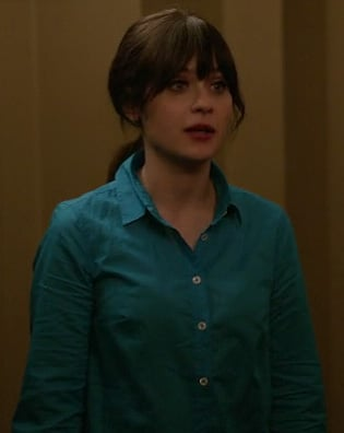 Jess Day's blue shirt with white buttons on New Girl