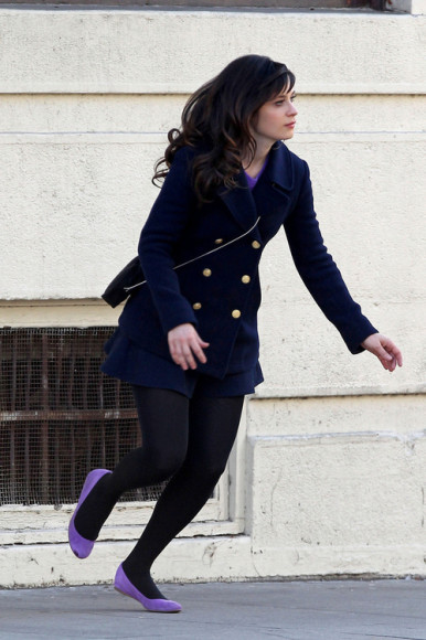 Jess's navy blue pea coat and purple flats on New Girl