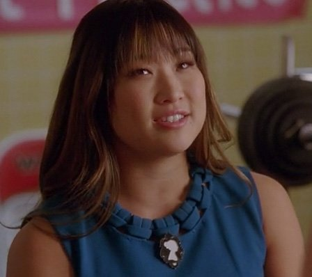 Tina's blue shift dress with black and white brooch on Glee