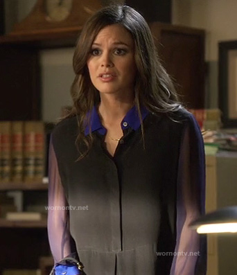 Zoe's black shirt with sheer sleeves and blue collar/cuffs on Hart of Dixie