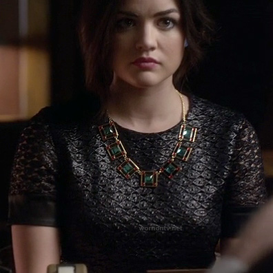 Aria's black textured short sleeve dress and green square necklace on Pretty Little Liars
