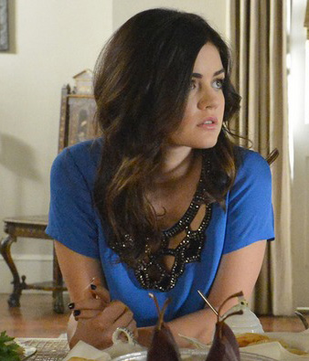 Aria's blue top with black rhinestone neckline on PLL