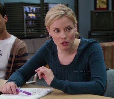 Britta's teal blue sweater with elbow patches on Community