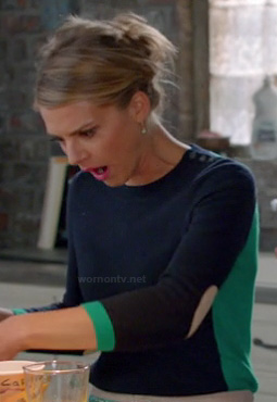 Jane's navy blue and green sweater with elbow patches on Happy Endings