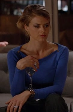 Jane's blue sweater with gold shoulder buttons on Happy Endings