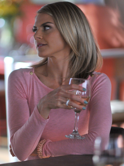 Jane's pink long sleeved top with gold shoulder buttons on Happy Endings