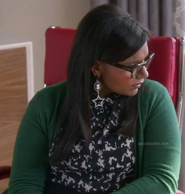 Mindy's black and white printed shirt with green cardigan and star earrings on The Mindy Project