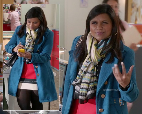 Mindy's blue coat with red/black/white colorblock skirt and green scarf on The Mindy Project
