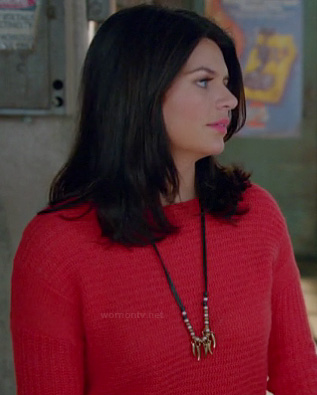 Penny's red knit sweater and long leather/gold necklace on Happy Endings
