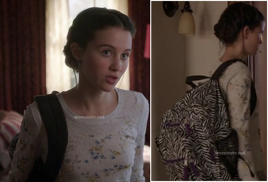 Sasha's zebra stripe backpack and white floral lace top on Bunheads