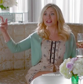 Alex's white button front printed dress and mint green cardigan on Happy Endings