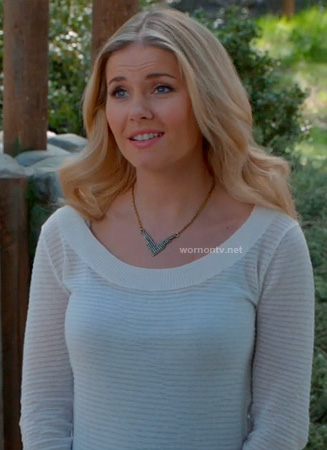 Alex's white striped sweatshirt and rhinestone necklace on Happy Endings