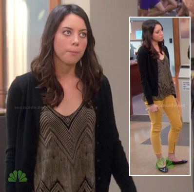 April's black chevron striped top with yellow ankle-zip jeans on Parks & Recreation