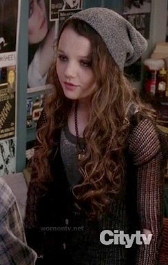 Dorrit's black mesh cardigan on The Carrie Diaries