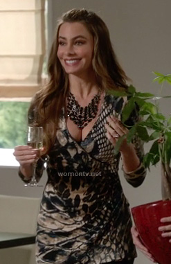 Gloria's snake print surplice top on Modern Family