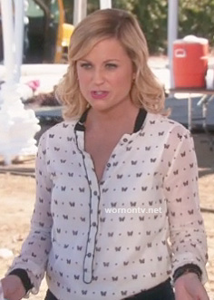 Leslie's white butterfly print top on Parks & Rec