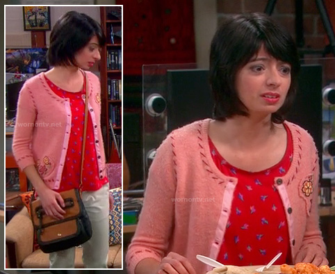 Lucy's red printed top, pink stitch cardigan