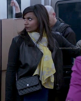Mindy's leather panel jacket, yellow scarf and blue/black skirt on The Mindy Project
