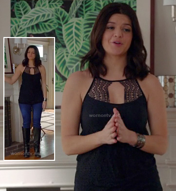 Penny's navy/black lace keyhole top worn with jeans and boots on Happy Endings