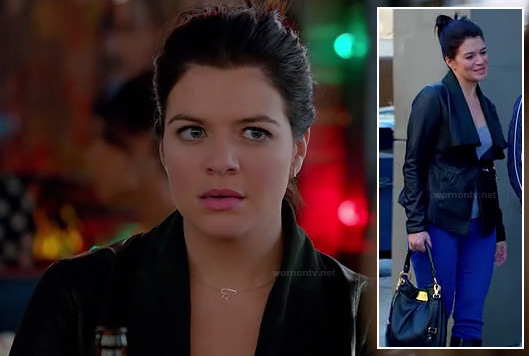 Penny's black leather jacket and back with sideways heart necklace on Happy Endings