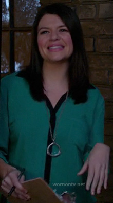 Penny's green blouse with contrast trim and long silver circle necklace on Happy Endings