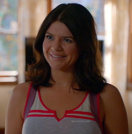 Penny's grey tank top with pink and purple trim and sideways heart necklace on Happy Endings