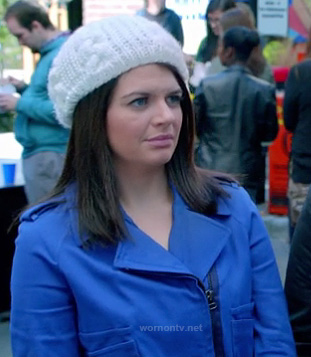 Penny's cobalt blue moto jacket and white knit beanie on Happy Endings