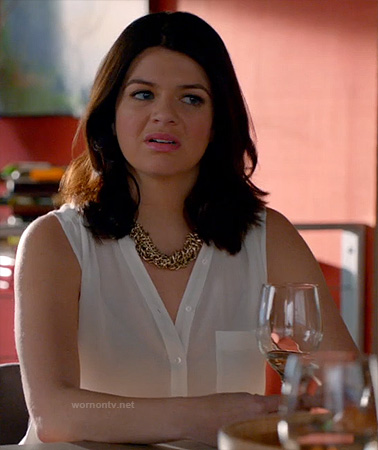 Penny's white sleeveless button front top on Happy Endings