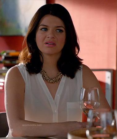 Penny's white sleeveless blouse on Happy Endings
