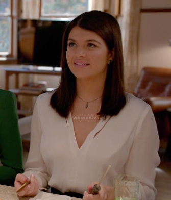Penny's white v-neck split blouse on Happy Endings