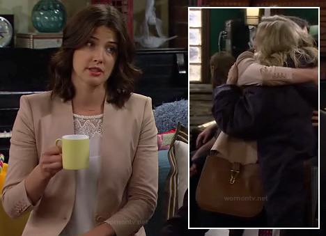 Robin's beige blazer, white lace top and tan purse on How I Met Your Mother