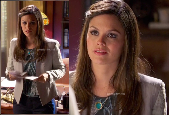 Zoe's light grey blazer, feather print top, pants with blue side stripes and turquoise circle necklace on Hart of Dixie