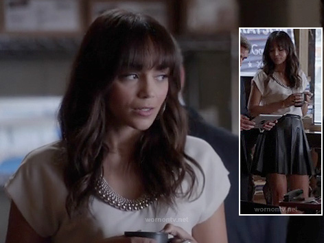 Ashley's white top with beaded neckline and black leather skirt on Revenge