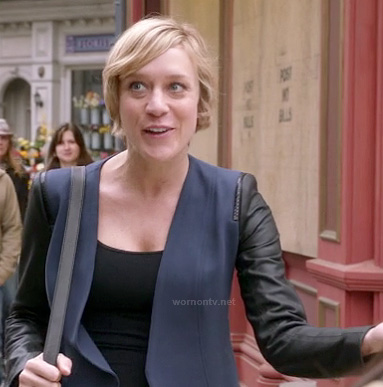 Christina (Chloe Sevigny)'s navy blazer with leather sleeves on The Mindy Project
