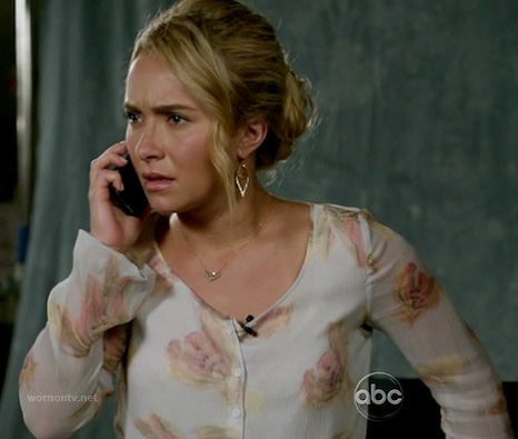 Juliette's white floral v-neck blouse on Nashville
