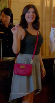 Penny's grey dipped hem skirt and red crossbody bag on Happy Endings