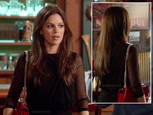 Zoe's sheer black dress with red bow purse on Hart of Dixie