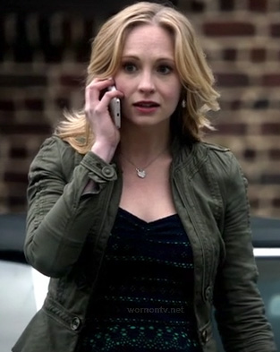 Caroline's army green peplum jacket and navy/green lace top on The Vampire Diaries