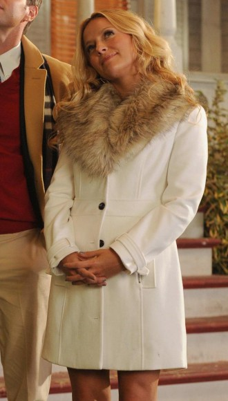 Chloe's white fur collar coat on The Goodwin Games