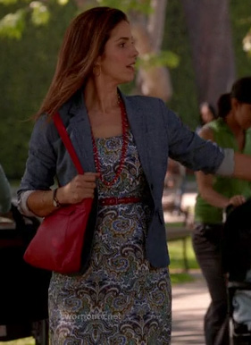 Marisol's paisley dress and red/black purse on Devious Maids