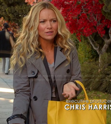 Chloe's grey trench coat with leather trim and yellow tote bag on The Goodwin Games